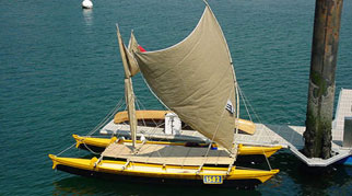 Tahiti Wayfarer double canoe with crabclaw sail up