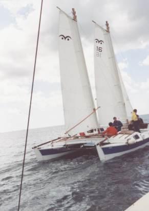 Tiki 31 with schooner rig passing Tiki 28