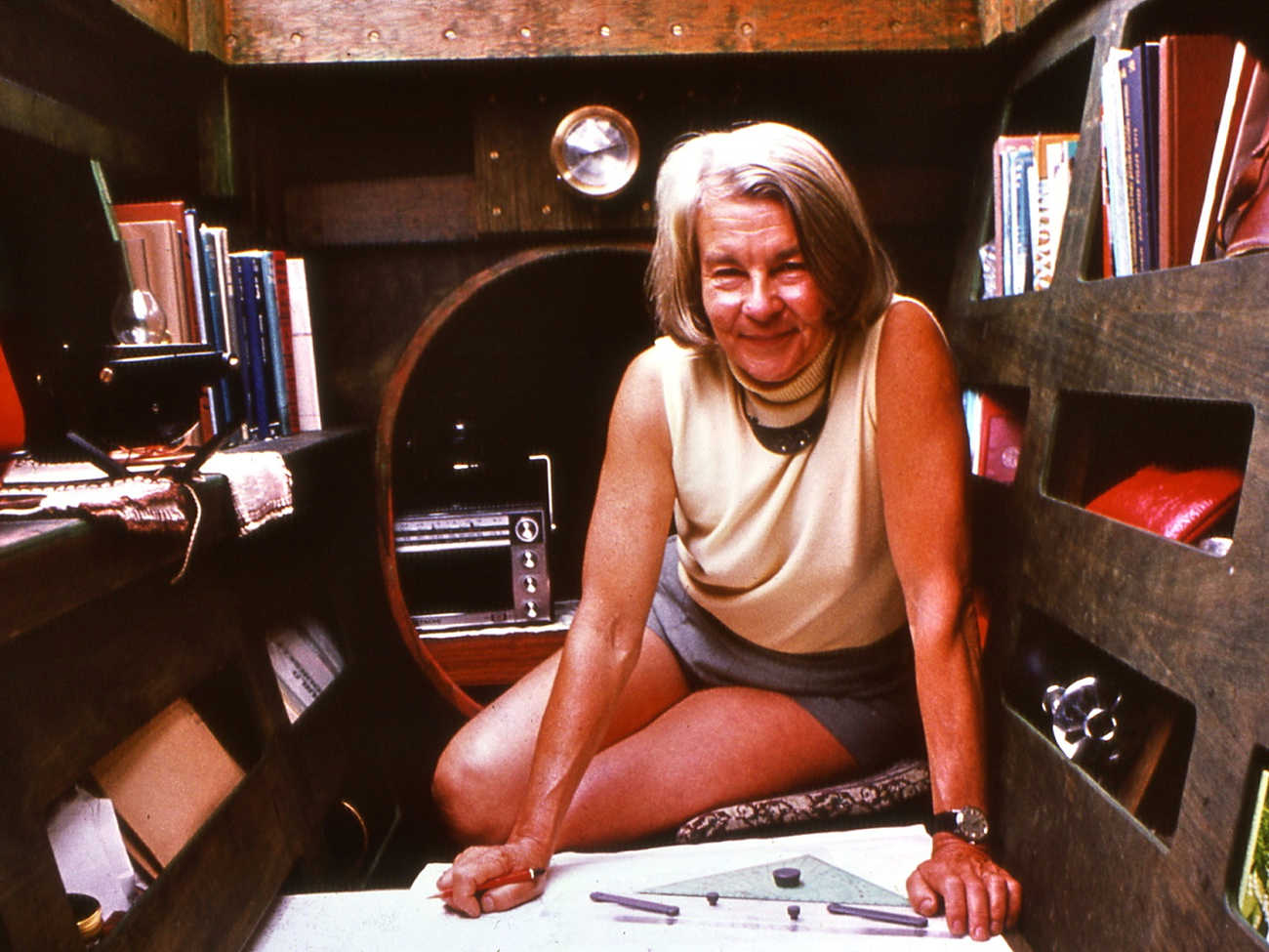 Ruth Wharram studying charts in a cabin