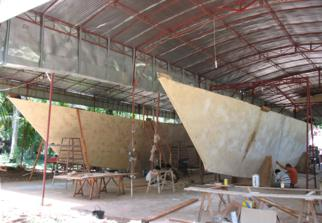 Large catamaran hulls under a roof