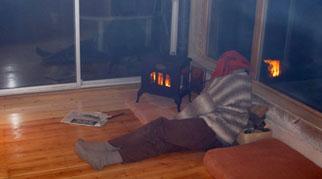 James sat next to a wood burning stove