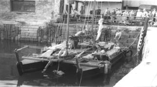 Black and white photo of Tangaroa at a quay