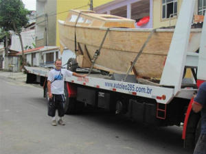 Tiki 30 hull on a truck