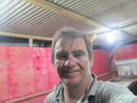 Rogerio Martin with sawdust on his face
