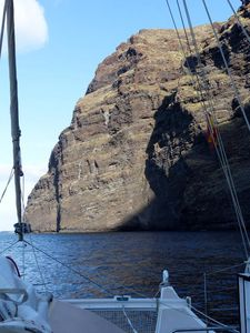 Hecate anchored next to huge cliffs