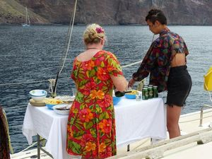 Food and drink for the wedding being prepared on deck