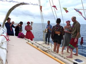 A band playing on deck of Hecate under sail