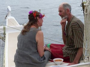 The newly weds sat together on deck