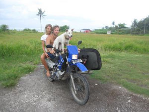 Bruno on motorbike with Charlotte and dog