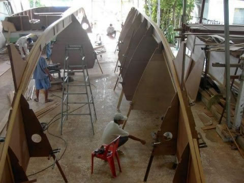 Partially completed Pahi 52 hulls flipped in a workshop