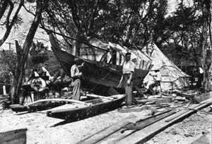 Eric De Bisschop next to partially constructed Kaimiloa hull