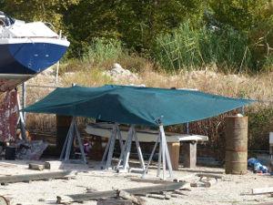 A small makeshift shelter at the boatyard