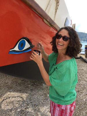 Casey repainting an eye on the hull