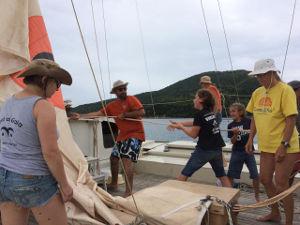 The crew hoisting sails