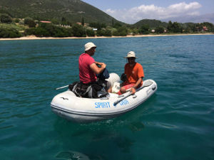Julius and Fabio in a rubber dinghy