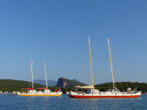 Two catamarans anchored next to each other
