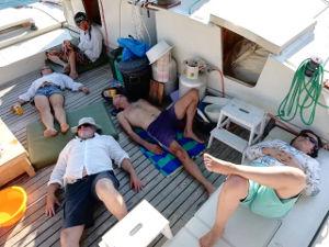 Crew lying down on deck
