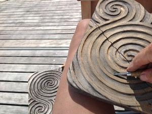 Pieces of wood with swirly patterns carved in them