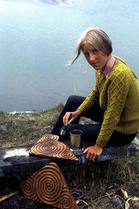 Hanneke making carved pieces of wood with spiral patterns