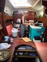 Amanda cooking in the galley