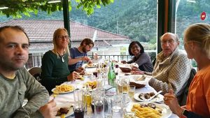 The crew having dinner in a restaurant