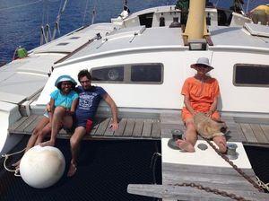 Giovanni, Kamila, Amanda and Oscar sitting on the bow