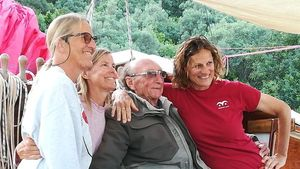 Four people smiling for the camera