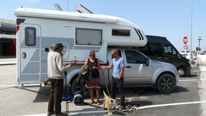 Paul, Amanda and James and Oscar the dog, outside a camper van