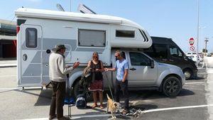 Paul, Amanda and James and Oscar the dog, outside a camper van