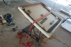 Hatch clamped to a workbench