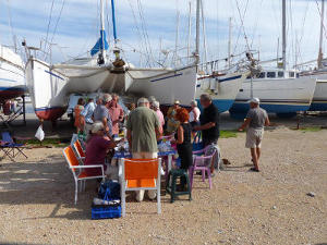 People gathering for a barbecue in the marina