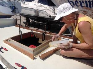 Hanneke working on hatch coamings