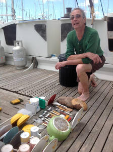 Paul next to his washing up on deck of Gaia