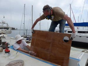 Paul and Hanneke lowering the deckpod panel in place