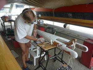Hanneke working on gaffs and masts underneath Gaia