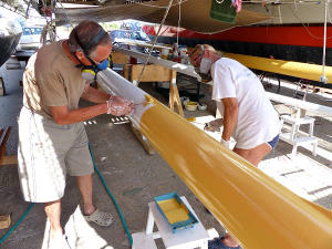 Painting masts under Gaia deck