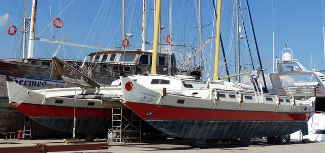 Gaia on land in the marina with her masts raised