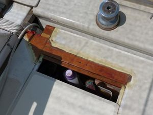 New wood installed where rotten wood previously was, top edge of deck hatch