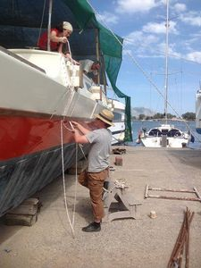 Bryce making a rope loop which he will use his weight on to tighten the beam lashings