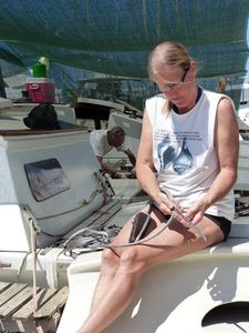 Hanneke making the final splices on deck