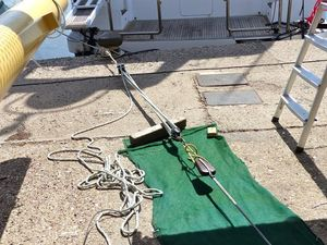 The new splices being stretched with a 6 part pulley tied to a bollard