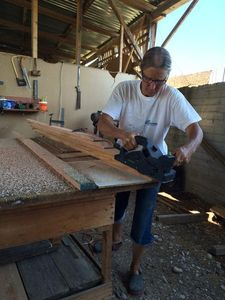 Hanneke using a power planer on the scarf of a platform slat