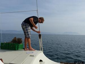 Pierre-Yves adjusting a lanyard whil Gaia is out at sea