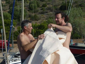 Two volunteers attaching the sail