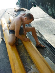 Frederik removing varnish from the masts