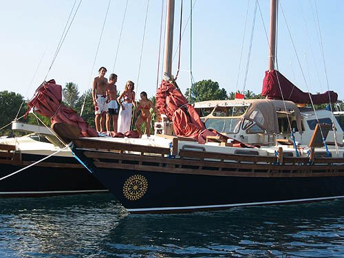 Islander 55 bow with people aboard