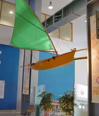 Outrigger canoe suspended from ceiling
