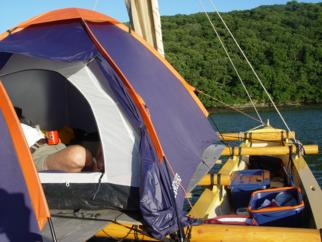 Tahiti Wayfarer double canoe with tent on deck