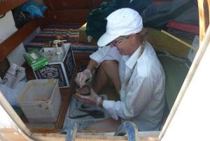 Hanneke mixing epoxy in the deckpod