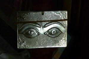 Silver plaque with eyes
